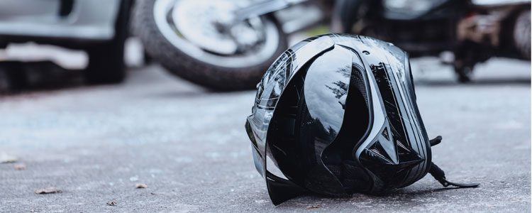 Motorcycle helmet laying on ground after a crash